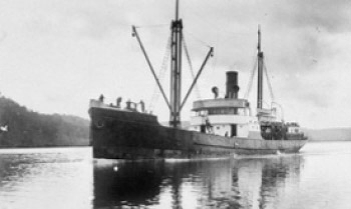 Black and white image of a ship on water.