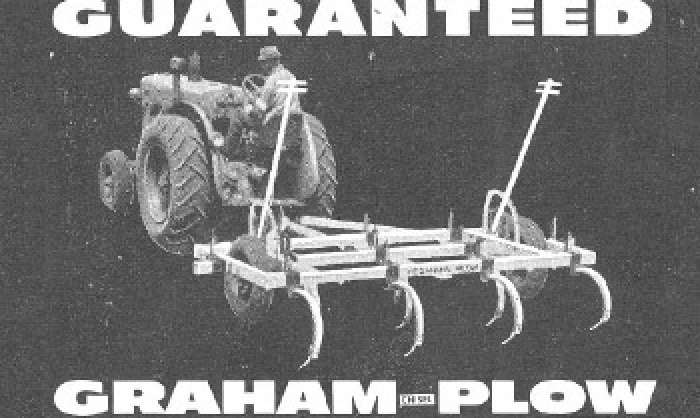 Black and white image of man on a plow.